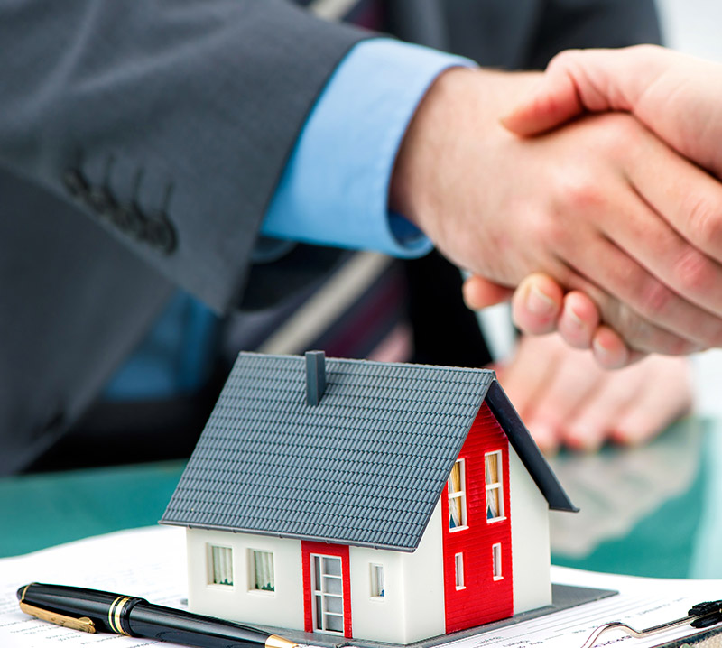 Business Handshake :: Buying A Property